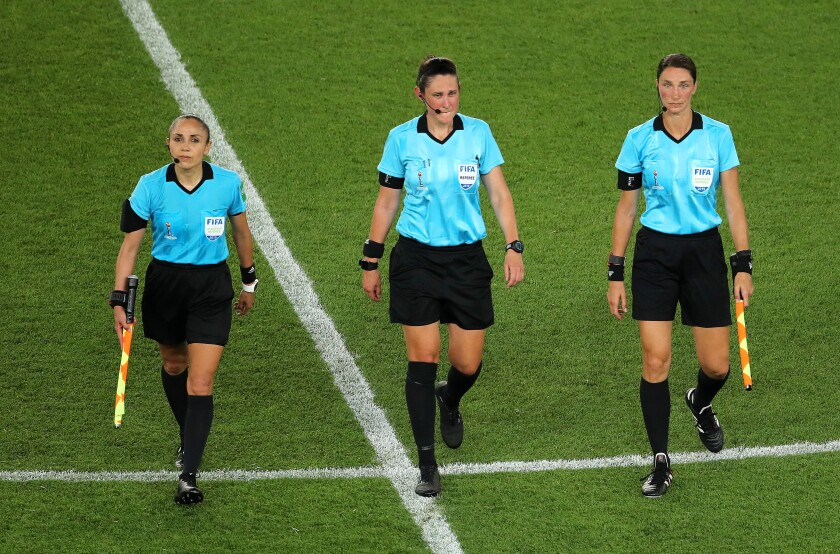 From left, Kate Jacewicz, Kathryn Nesbitt, Felisha Mariscal leave the pitch after the 2019 FIFA Women's World Cup match.
