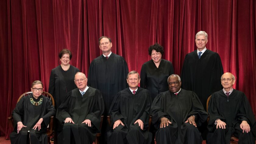 The justices of the U.S. Supreme Court gather for an official group portrait to include new Associate Justice Neil Gorsuch, top row, far right, Thursday. June 1, 2017, at the Supreme Court Building in Washington.
