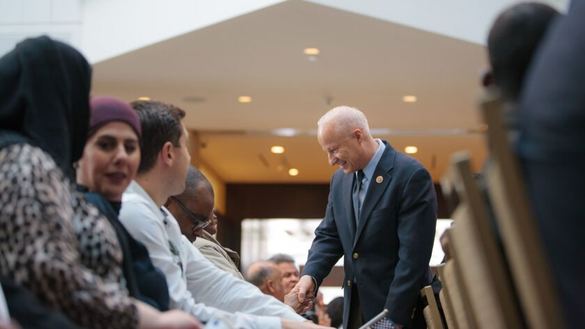 Denver, CO - FEBRUARY 22, 2018: Rep. Mike Coffman (CO-06) talks with people before a USCIS Ceremony