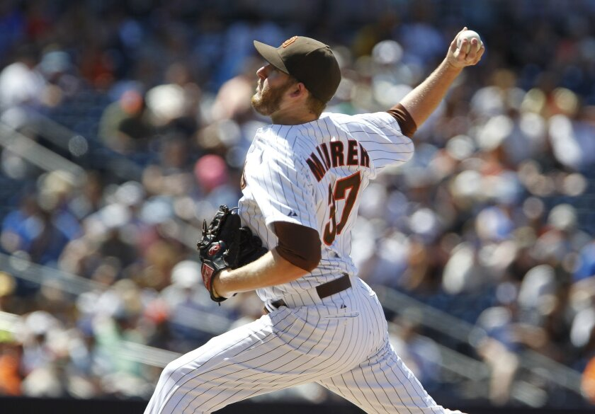 The Padres' Brandon Maurer pitches to the Giants in the seventh inning.