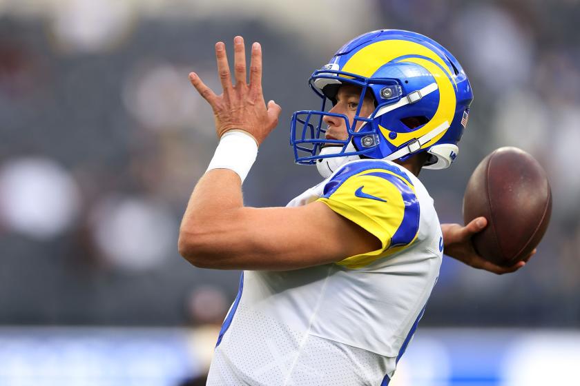 Matthew Stafford, in Rams uniform, throws the football during warmups.