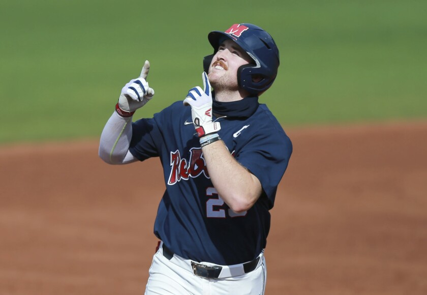 Mississippi's Tim Elko points skyward as he runs around the bases after hitting his second home run against Southern Mississippi during an NCAA college baseball tournament regional game Monday, June 7, 2021, in Oxford, Miss. (Thomas Wells/The Northeast Mississippi Daily Journal via AP)