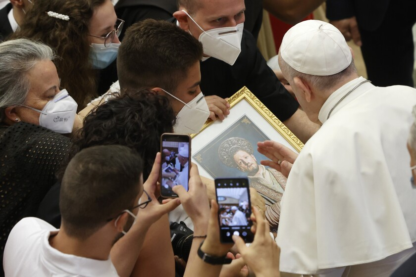 Pope Francis greets the faithful at the end of his weekly general audience in the Paul VI hall at the Vatican, Wednesday, Aug. 11, 2021. (AP Photo/Riccardo De Luca)