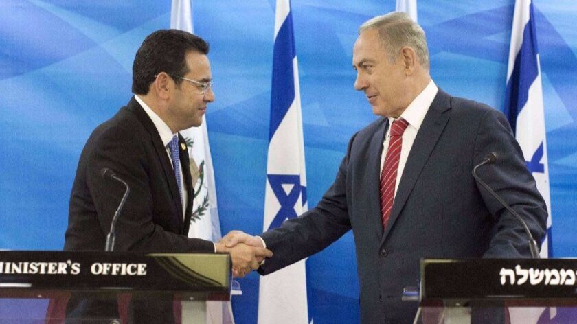Guatemalan President Jimmy Morales, on the left, and Israeli Prime Minister Benjamin Netanyahu at a joint press conference on November 28, 2016.