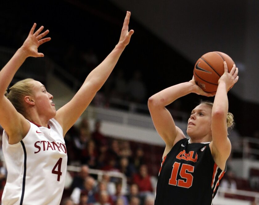 Oregon State's Jamie Weisner, right, shoots against Stanford's Taylor Greenfield (4) during the first half of an NCAA college basketball game Sunday, Jan. 5, 2014, in Stanford, Calif. (AP Photo/Ben Margot)