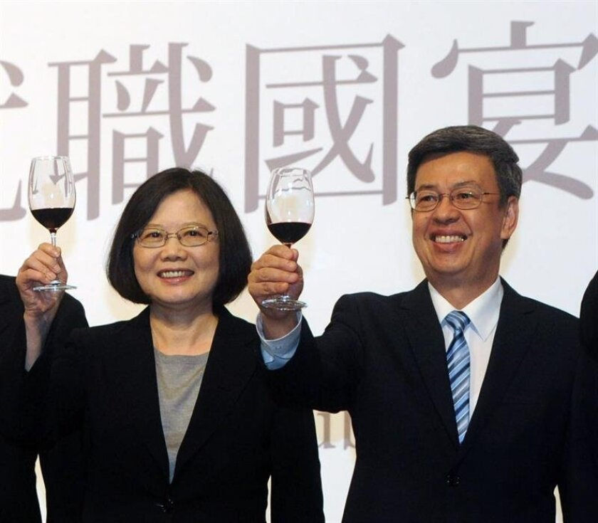 """Taiwan President Tsai Ing-wen waves to the crowd during her speech after swearing as the 14th President of Taiwan, Taipei, Taiwan, 20 May 2016. China on 21 May 2016 threatened to cease bilateral communications with Taiwan if the island nation does not acknowledge there is """"only one China"""", a day after new Taiwanese President Tsai Ing-wen's inaugural address was criticized by Beijing for its 'ambiguity'. Ma Xiaoguang, spokesman for the Chinese State Council Taiwan Affairs Office, warned that Taipei must """"confirm adherence"""" to the 1992 Consensus if it wished to continue regular communications with Beijing. EPA/RITCHIE B. TONGO"""