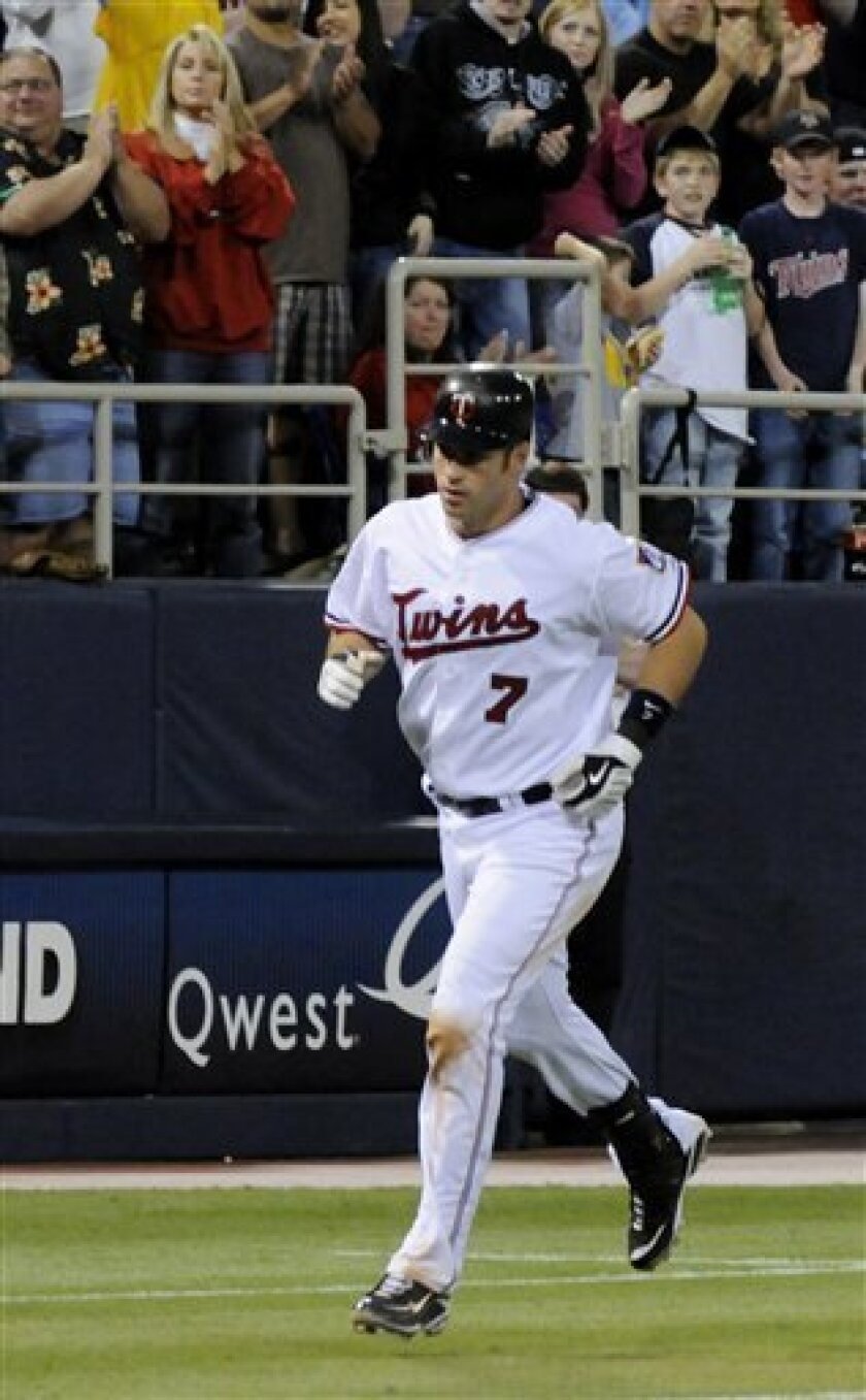 Minnesota Twins' Joe Mauer heads home after a solo home run off Seattle Mariners pitcher Felix Hernandez in the third inning of a baseball game Saturday, May 9, 2009 in Minneapolis. Mauer also had two RBIs in the first inning. (AP Photo/Jim Mone)