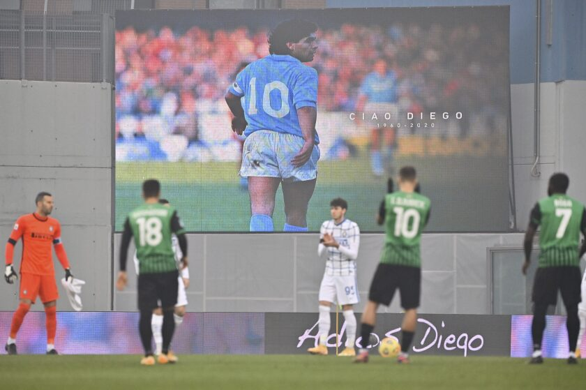 An image of Diego Armando Maradona is projected on a giant screen prior to the Serie A soccer match between Sassuolo and Inter Milan at the Mapei Stadium in Reggio emilia, Italy, Saturday, Nov. 28, 2020. (Massimo Paolone/LaPresse via AP)