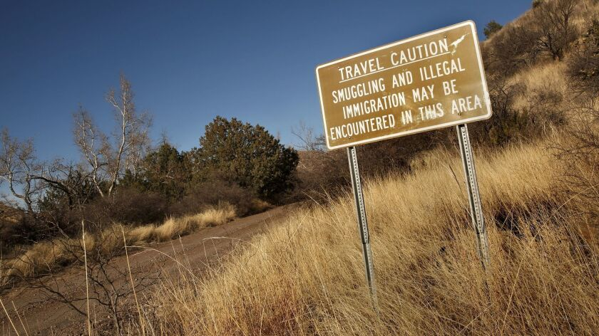 Forty miles east of Douglas, Ariz., not far from the property of rancher Sue Krentz, a warning sign.