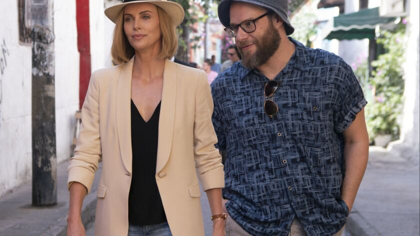 Charlotte Fields (CHARLIZE THERON) and Fred Flarsky (SETH ROGEN) in LONG SHOT.