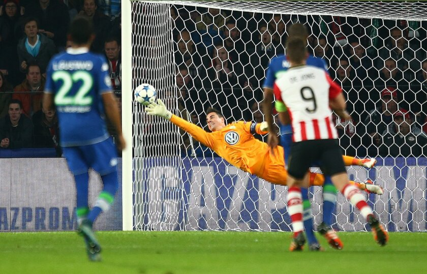 Wolfsburg's goalkeeper Diego Benaglio dives for the ball during the Champions League Group B soccer match between PSV and VfL Wolfsburg at Philips stadium in Eindhoven, Netherlands, Tuesday, Nov. 3, 2015. (AP Photo/Peter Dejong)
