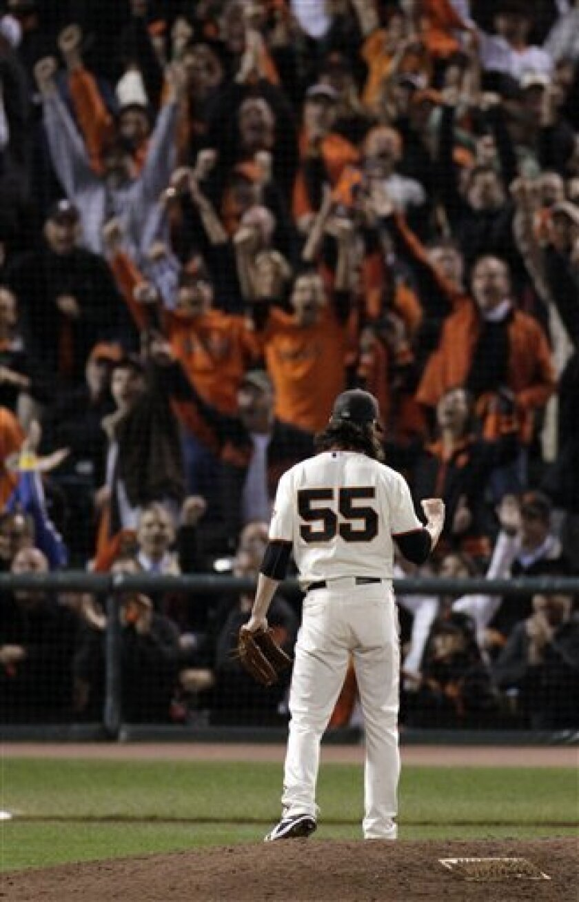 San Francisco Giants starting pitcher Tim Lincecum pumps his fist after striking out Atlanta Braves' Derrek Lee for the final out of Game 1 of baseball's National League Division Series in San Francisco, Thursday, Oct. 7, 2010. The Giants won 1-0. (AP Photo/Jeff Chiu)