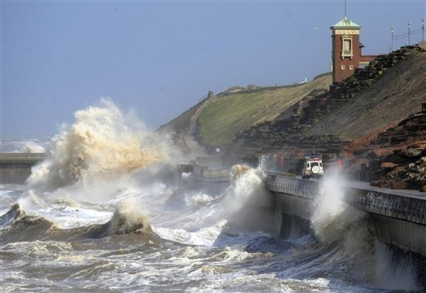 Gales and high tides sweep the coast at Blackpool, in the north west of England, as the remnants of Hurricane Katia hit British shores, Monday Sept. 12, 2011. The second stage of the Tour of Britain was cancelled for safety reasons due to high winds across Monday's competition route. Britain's weather agency says the tail end of former Hurricane Katia could bring the worst storms to hit the country in 15 years. Britain's Met Office said post Tropical Storm Katia was hitting parts of Northern Ireland, North Wales, Northern England and parts of Scotland on Monday. It said the storms could be the worst to hit Britain since 1996 when the aftermath of Hurricane Lili brought winds of 90 mph (145 kph) to the country. (AP Photo/PA, John Giles) UNITED KINGDOM OUT NO SALES NO ARCHIVE
