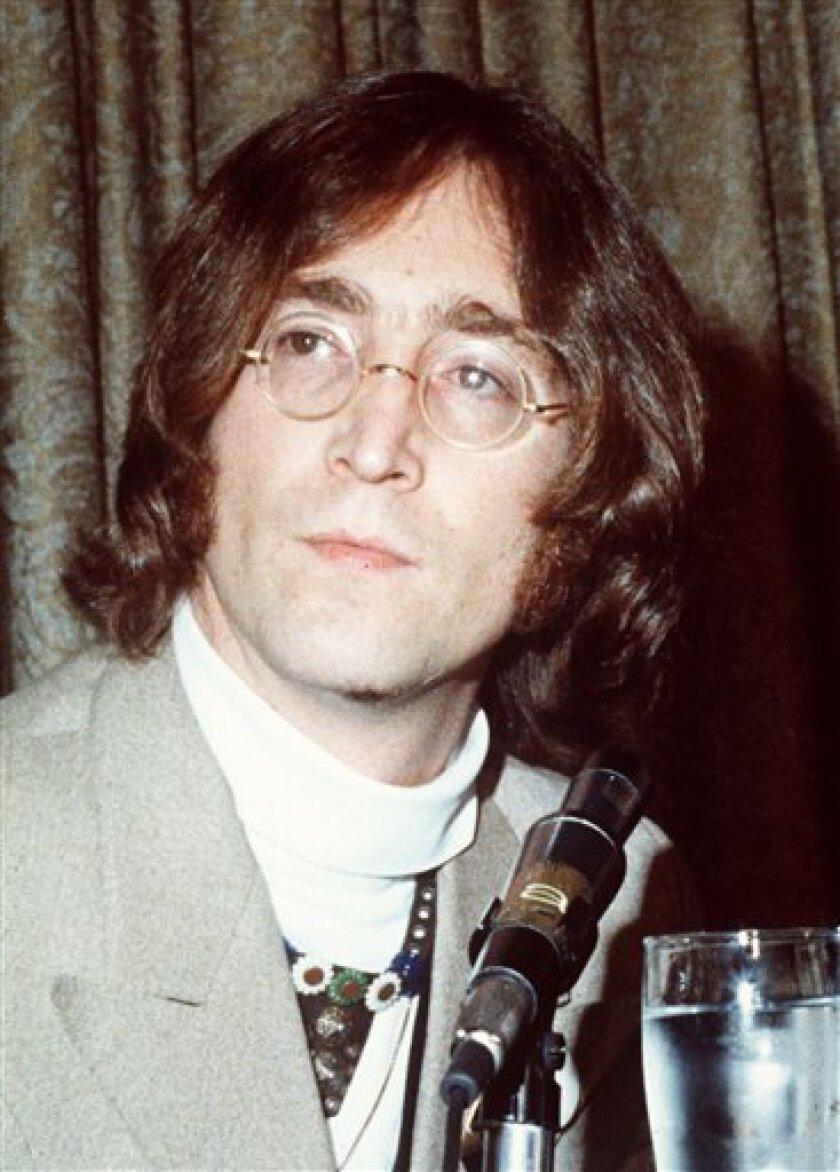 FILE - This undated file photo shows John Lennon. It's hard to imagine which event sounds more implausible: John Lennon's 70th birthday, Saturday Oct. 9, 1940; or the 30th anniversary of his murder - Dec. 8, 1980. (AP Photo, file)
