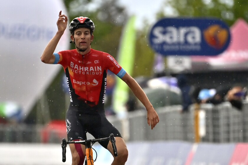 Switzerland's Gino Mader celebrates after winning the sixth stage of the Giro d'Italia cycling race, from Grotte di Frasassi to Ascoli Piceno Thursday, May 13, 2021. (Massimo Paolone/LaPresse via AP)