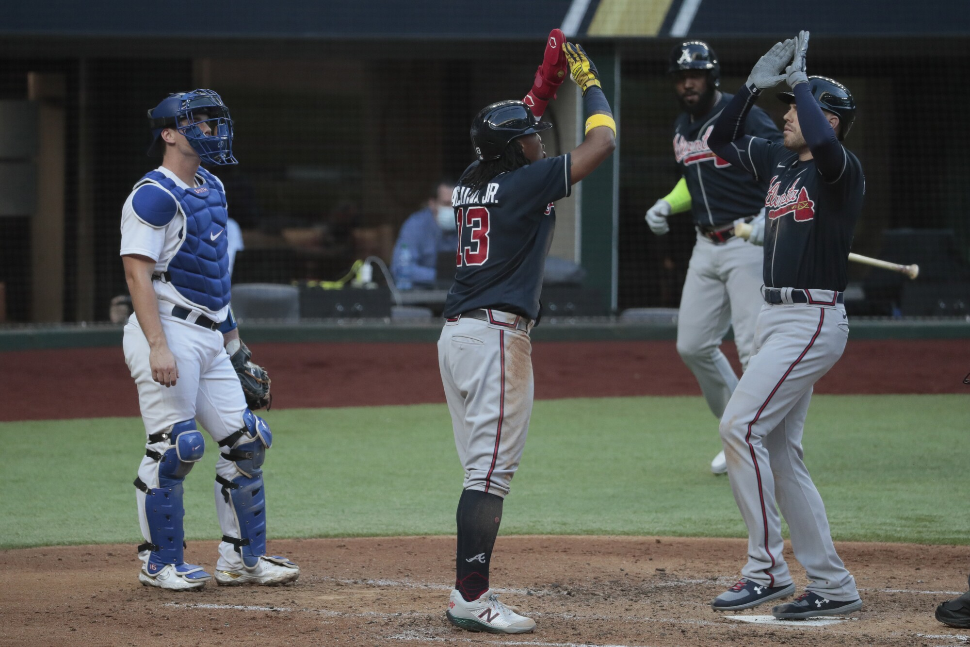 Atlanta's Freddie Freeman, right, celebrates with teammate Ronald Acuna Jr. after hitting a two-run home run.