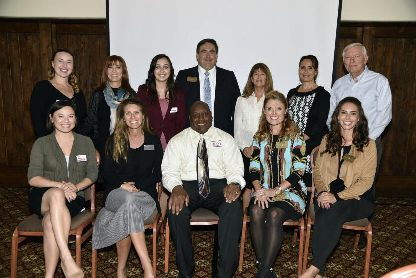 RSF Rotary 2017 Taste of Rancho Santa Fe beneficiaries- standing: Dana Howorth of ConnectMed International, Joani Wafter of Kids Korp USA, Dawn Myers of CSUSM, RSF Rotary President Luis Carranza, Pat Hall of Cancer Angels of San Diego, Rhina Paredes of Eric Paredes of Save A Life Foundation, Jim Boyce of Future Legends. Seated: Lucy Lu of ConnectMed International, Dorell Phillips Sacket of Spay-Neuter Action Project, James Cooley of JC Cooley Foundation, Taste of Rancho Santa Fe 2017 Chair Lauren Reynolds, RSF Rotary Foundation President Laura MacKinnon