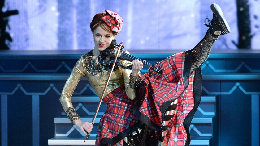 """Lindsey Stirling performs in """"CMA Country Christmas"""" on ABC."""