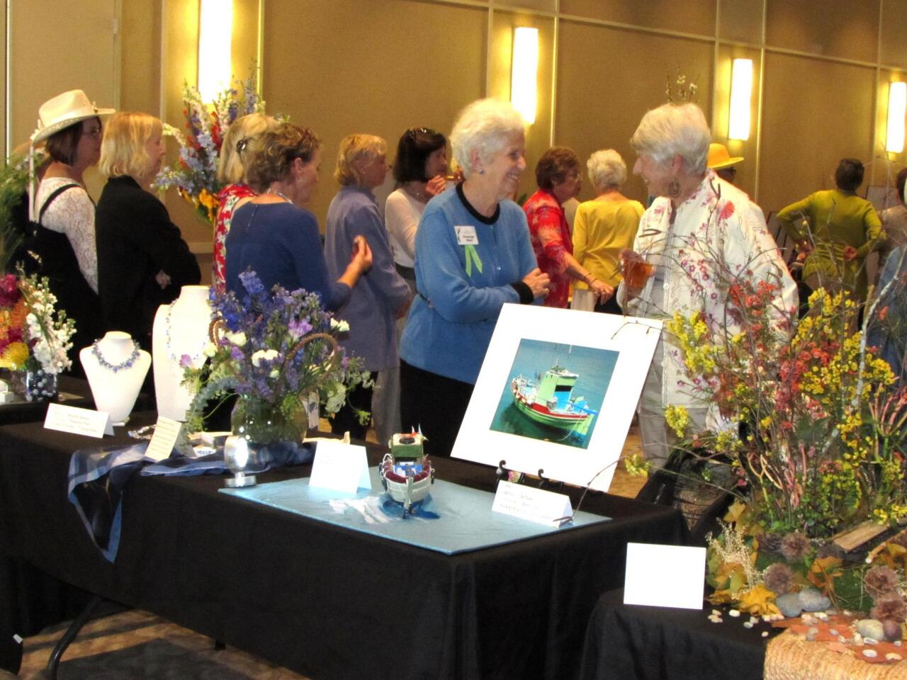 Floral designer Penelope West (left) chats with artist Jan Nelte about their submissions to 'Expresssions in Art and Flowers' 2017.
