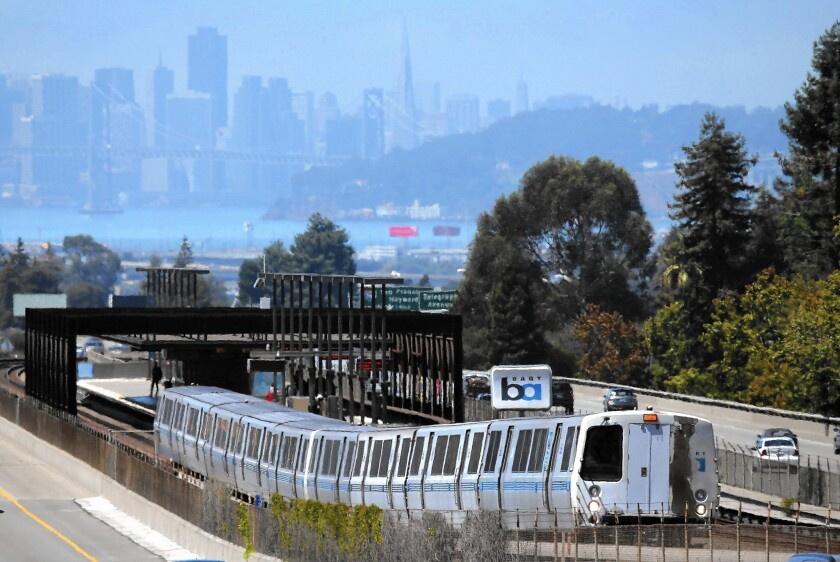 A Bay Area Rapid Transit train pulls away from the Rockridge station in Oakland.