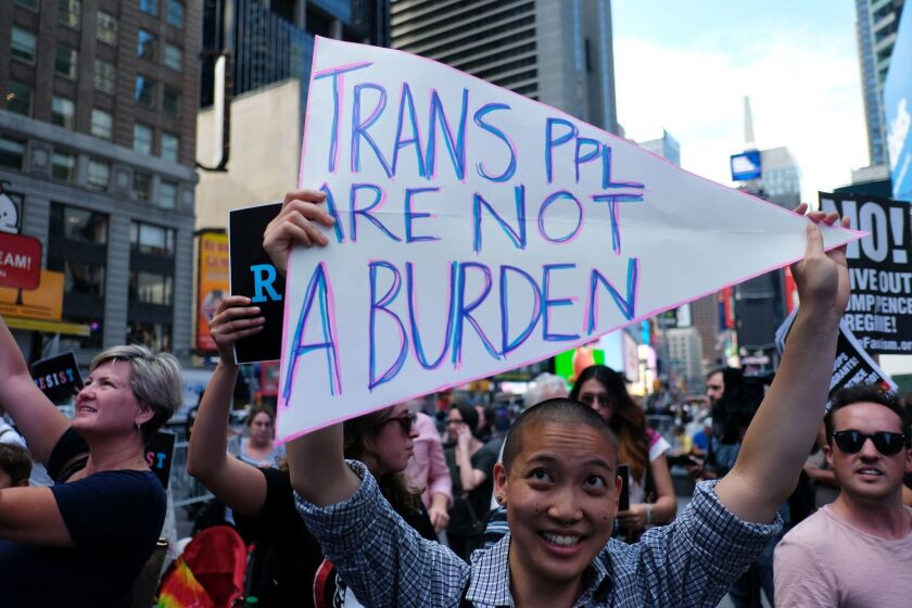 """Protesters rallied in Times Square last year after President Trump announced that transgender people may not serve """"in any capacity"""" in the US military, citing the """"tremendous medical costs and disruption"""" their presence would cause."""
