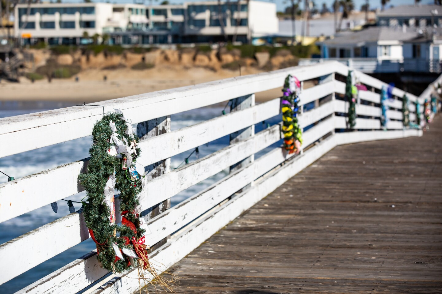 Christmas on Crystal Pier in Pacific Beach featured Christmas lights, wreaths and a large tree at the end of the pier.