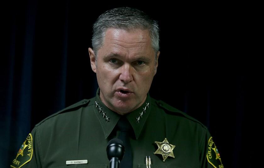 Orange County Sheriff Don Barnes speaks during a media briefing in Santa Ana.