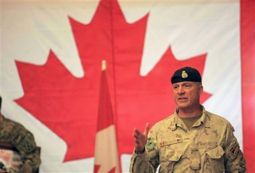 Brig.-Gen Dean Milner, Commander of Canadian Forces Kandahar gestures as he leave after a transfer of command authority ceremony in Kandahar airbase in Afghanistan, Thursday, July 7, 2011.Canadian combat operations have ended and their troops will transition to a non-combat training role with up to 950 soldiers and support staff to train Afghan soldiers and police in areas of the north, west and Kabul.((AP Photo/Rafiq Maqbool)