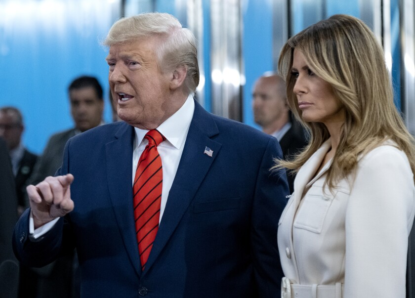 President Trump and First Lady Melania Trump arrive Tuesday at U.N. headquarters.