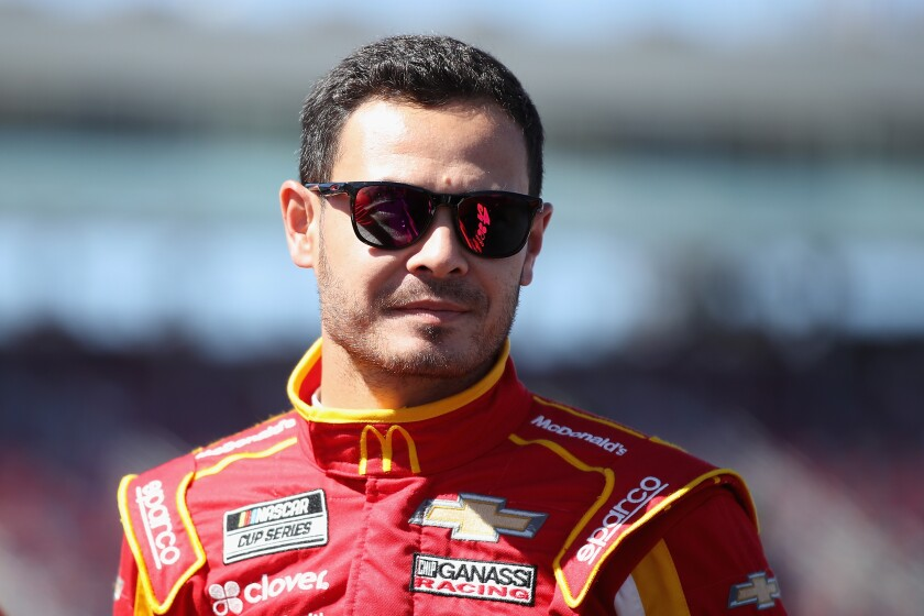 Kyle Larson stands near the track at Phoenix Raceway.