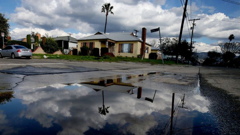 LOS ANGELES, CALIF. - JAN. 24, 2017. Rain water collects at the end of the 7700 block of Klump Aven