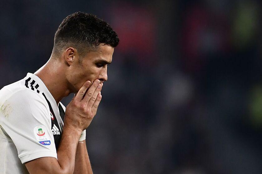 Juventus' Portuguese forward Cristiano Ronaldo reacts during the Italian Serie A football match Juventus vs Napoli on September 29, 2018 at the Juventus stadium in Turin.
