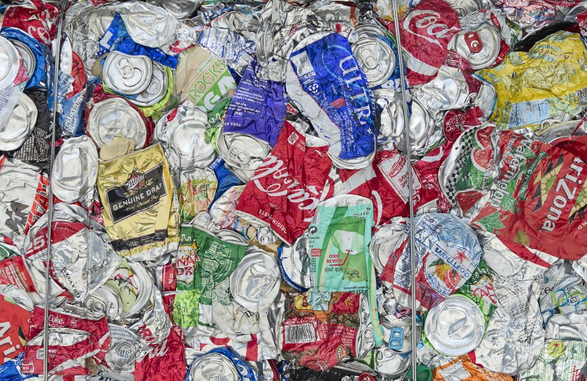 Crushed aluminum cans at a recycling center.