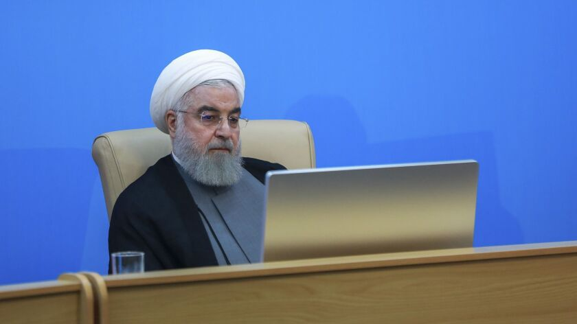 Iranian President Hassan Rouhani attends a meeting with Health Ministry officials in Tehran on June 25.