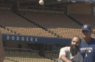 Curiosity Correspondent: Learn to throw a pitch in 60 seconds