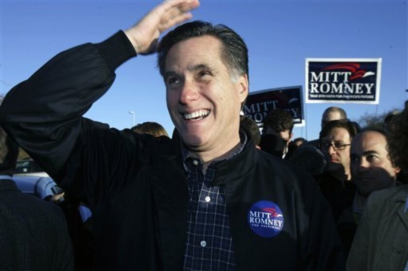 FILE - In this Jan. 19, 2008 file photo, Republican presidential hopeful former Massachusetts Gov. Mitt Romney makes a joke about his hair as he greets supporters at a polling station on Nevada caucus day in Las Vegas, Herman Cain thinks Rick Perry is a good governor, Newt Gingrich is brilliant and Michele Bachmann is a very nice lady. What about Mitt Romney? Nice hair. (AP Photo/LM Otero, File)