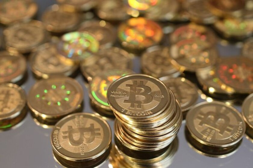 Advocates of the digital currency bitcoin have touted it as a refuge from the stock market's volatility, but in the early days of the bear market it has been anything but.