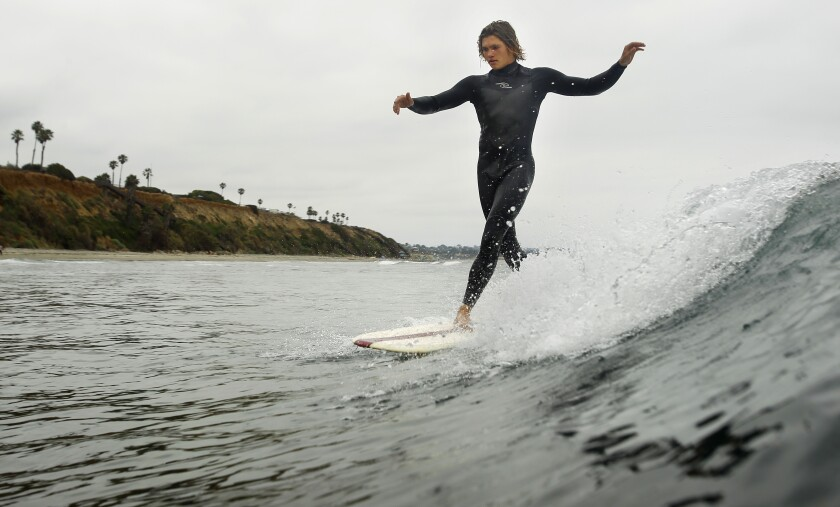 Vinny Couch surfs in Encinitas near the north end of San Elijo State Park on June 26, 2019. Heal the Bay announced that this area is one of 12 beaches in San Diego County that made it on the Honor Roll for the annual beach report card, a coveted list of spots with perfect water quality scores.