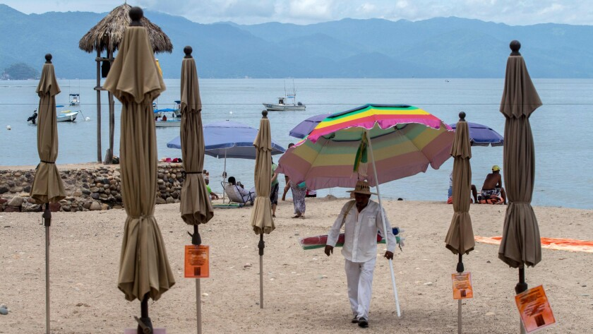 People enjoy the beach in the resort city of Puerto Vallarta, Mexico.