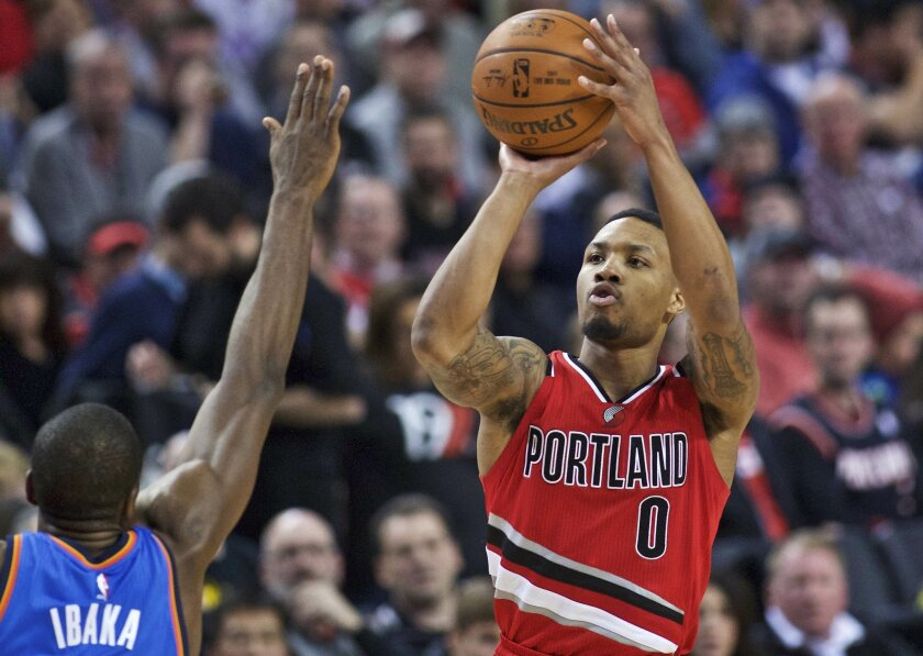 FILE - In this Sunday, Jan. 10, 2016 file photo, Portland Trail Blazers guard Damian Lillard shoots over Oklahoma City Thunder forward Serge Ibaka during the second half of an NBA basketball game in Portland, Ore. At the All-Star break, the Blazers are at .500 (27-27) and surprisingly sit in sevent