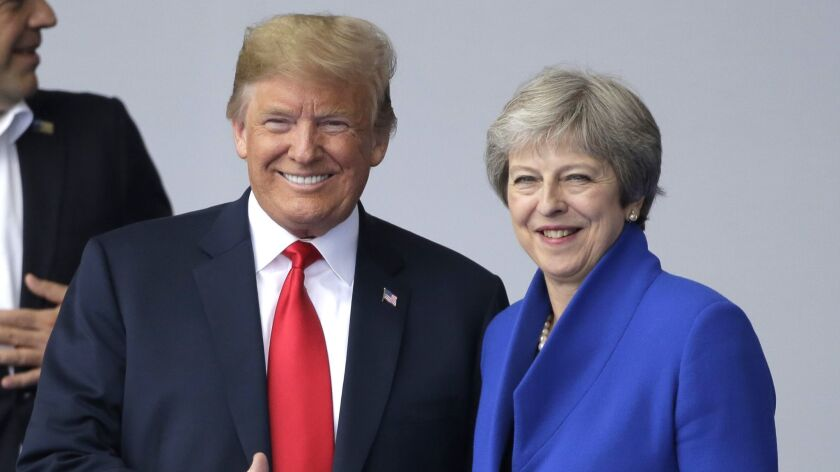 In this July 11, 2018, photo, U.S. President Donald Trump, left, talks to British Prime Minister The