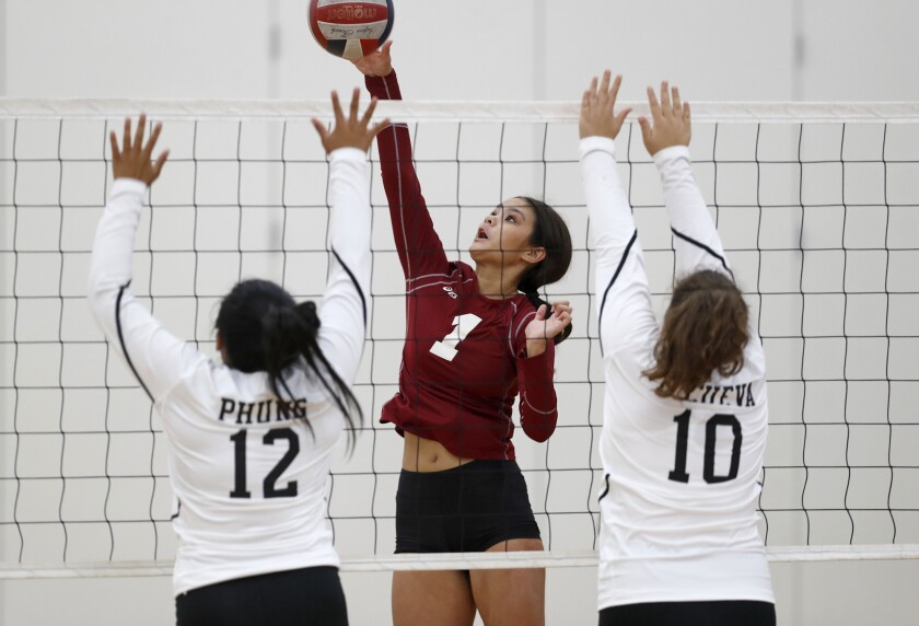 Estancia's Sydney Bilderback (1) battles at the net in the first set against Bolsa Grande on Tuesday in a nonleague match.