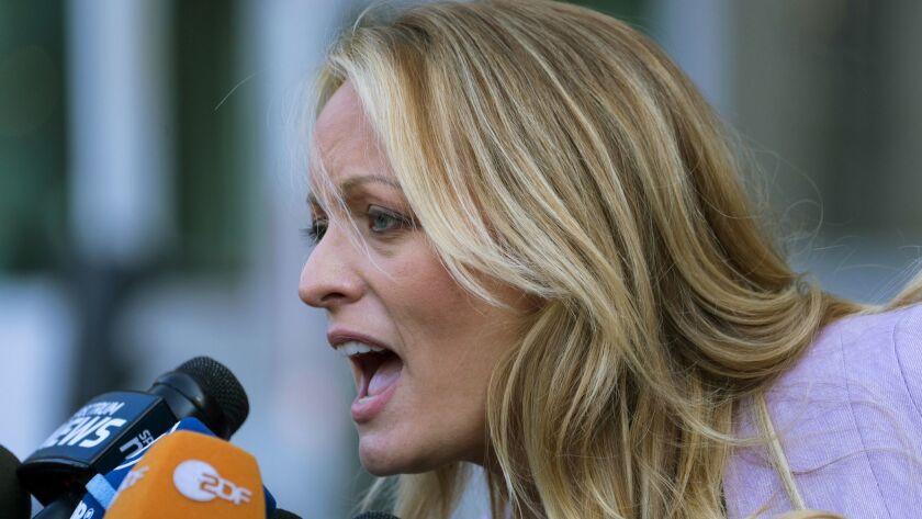 Adult film actress Stormy Daniels speaks to members of the media after a hearing at federal court Mo