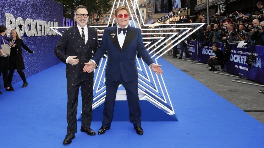 FILE - In this May 20, 2019, file photo, musician Elton John and his husband producer David Furnish,