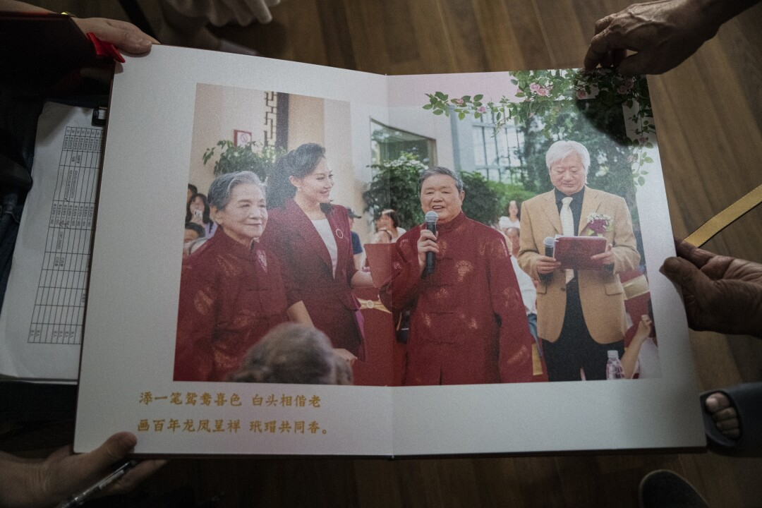 In October 2019, Grandpa Xu and Grandma Wu had been celebrated in a city ceremony for the the nation's 70th anniversary, which coincided with their 70th wedding anniversary. In January 2020, seven members of their family fell sick after having dinner together, unaware of the coronavirus spreading in Wuhan. Two of them died.