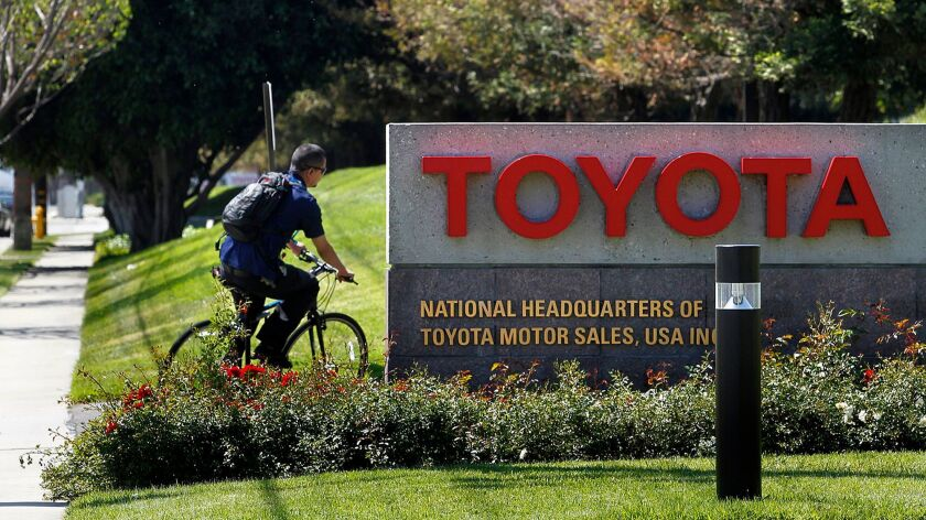 A bicyclist pulls into Toyota's U.S. Headquarters in Torrance in April 2014. Toyota will be completing the move of its U.S. headquarters to Plano, Texas this year and has put the 110-acre South Bay campus on the market.