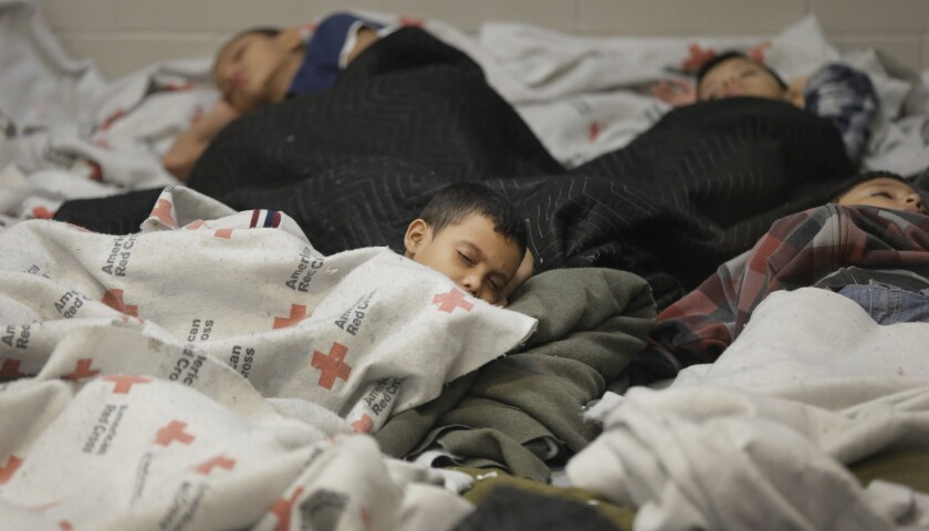 Detainees sleep in a holding cell at a U.S. Customs and Border Protection processing facility in Brownsville, Texas. House Minority Leader Nancy Pelosi (D-San Francisco) expressed little hope for immigration reform after visiting a border facility Saturday.