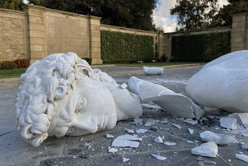 """Shown is the broken marble head of Forest Lawn Memorial Park's reproduction of Michelangelo's """"David."""" The statue toppled over Sunday morning."""