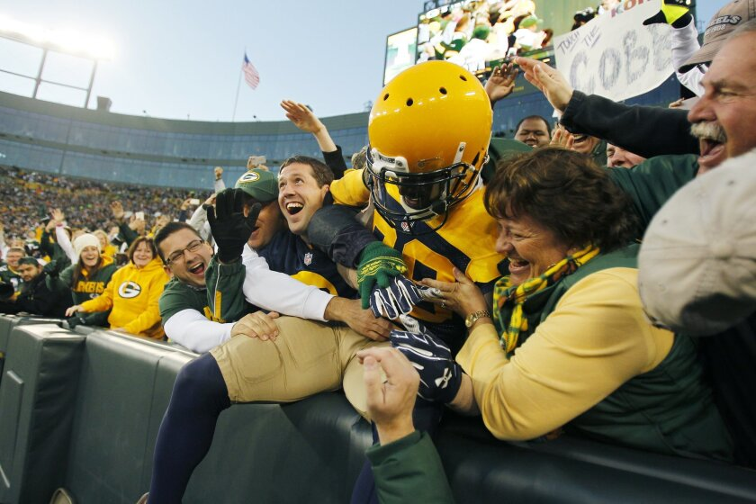 Packers James Jones celebrates a touchdown with fans against the Chargers in the 3rd quarter.