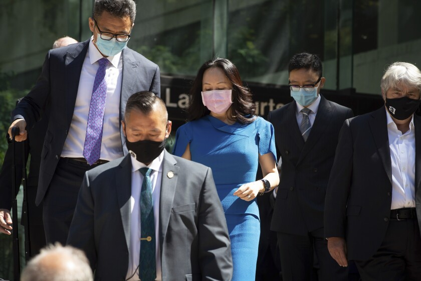 Meng Wanzhou, chief financial officer of Huawei, leaves British Columbia Supreme Court during a break from her extradition hearing, in Vancouver, British Columbia, Wednesday, Aug. 4, 2021. (Darryl Dyck/The Canadian Press via AP)